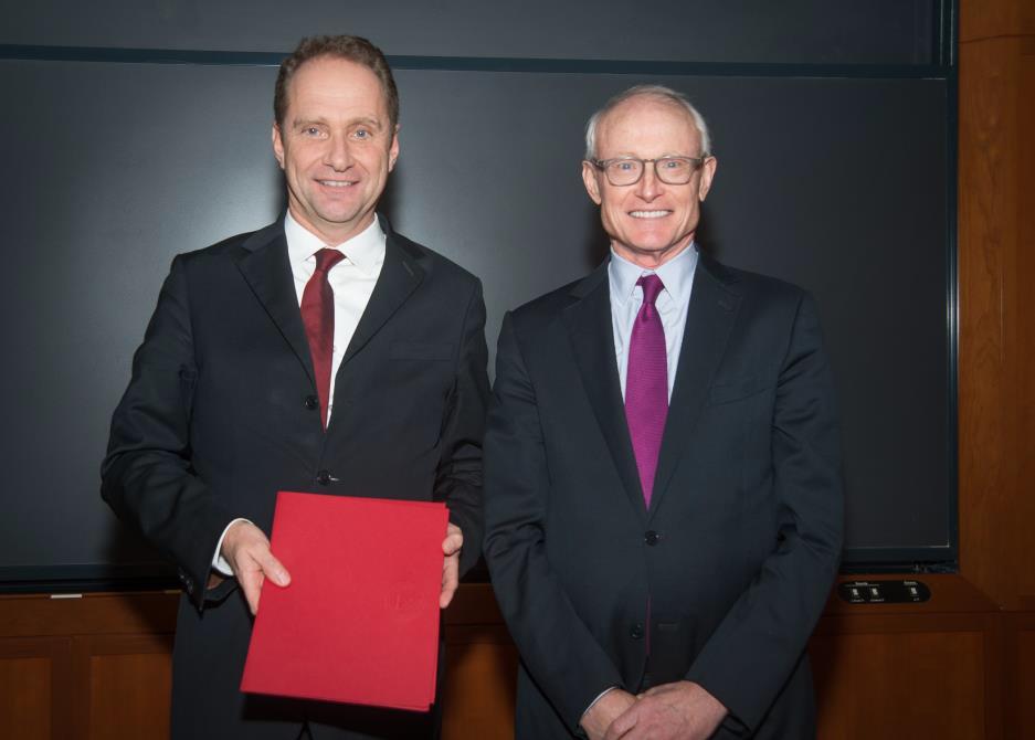 Prof. P. Gugler and Prof. M. E. Porter (Boston, December 2016)
